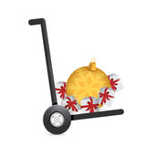 Christmas ornaments and gifts on a dolly. Royalty Free Stock Photos