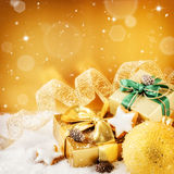 Christmas ornaments and gifts in golden tone Stock Photography