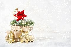 Christmas ornaments gifts lights background. Christmas ornaments and gifts with on lights background stock image