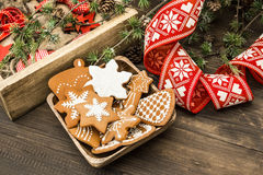 Christmas ornaments and gingerbread cookies. Home decoration. Vintage style toned picture Royalty Free Stock Photos
