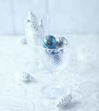 Christmas ornaments in a glass Royalty Free Stock Photos
