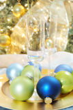 Christmas ornaments & glasses. A Christmas still life with ornaments and glasses stock photo