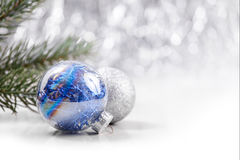 Christmas ornaments on glitter bokeh background. Silver and Blue Christmas ornaments on glitter bokeh background with space for text. Xmas and Happy New Year Stock Photos