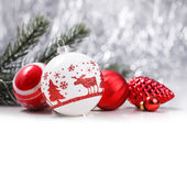 Christmas ornaments on glitter bokeh background. White and red Christmas ornaments on glitter bokeh background with space for text. Xmas and Happy New Year theme Royalty Free Stock Photos