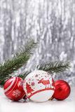 Christmas ornaments on glitter bokeh background. White and Red Christmas ornaments on glitter bokeh background with space for text. Xmas and Happy New Year theme Royalty Free Stock Image