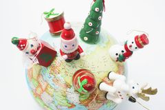 Christmas Ornaments on Globe Stock Photos