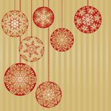 Christmas Ornaments on a Gold Background. Christmas Ornaments on a Gold Striped Background Background Stock Image