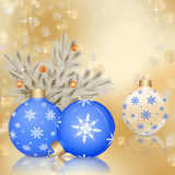 Christmas ornaments on golden background. Blue Christmas ornaments on golden background with Christmas lights and stars Stock Photos