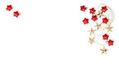 Christmas ornaments Golden stars red baubles flat lay Stock Images