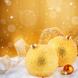Christmas ornaments in golden tone. With copyspace Stock Photos