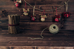 Christmas ornaments handmade on vintage brown wooden background. Royalty Free Stock Images