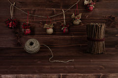 Christmas ornaments handmade on vintage brown wooden background. Royalty Free Stock Photo