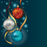 Christmas ornaments hanging on gold thread. Royalty Free Stock Photo