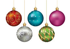 Christmas ornaments hanging on gold thread. Royalty Free Stock Images