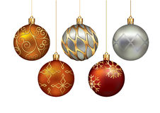 Christmas ornaments hanging on gold thread. Stock Photo