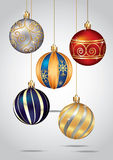 Christmas ornaments hanging on gold thread. Royalty Free Stock Photography