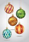 Christmas ornaments hanging on gold thread. Stock Images