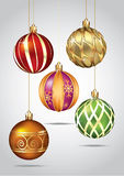 Christmas ornaments hanging on gold thread. Royalty Free Stock Image