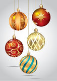 Christmas ornaments hanging on gold thread. Stock Photography
