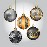 Christmas ornaments hanging on gold thread. Stock Photos