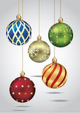 Christmas ornaments hanging on gold thread. Stock Image