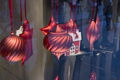 Christmas ornaments hanging red tape, a showcase of clothes. In the city Royalty Free Stock Images