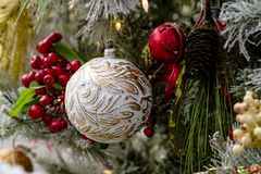 Christmas ornaments hanging on tree. White and gold antique ornament hanging on decorated Christmas tree Stock Photography