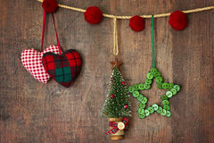Christmas ornaments hanging on wood Stock Photo