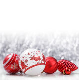 Christmas ornaments on holiday background. White and Red Christmas ornaments on glitter bokeh background with space for text. Xmas and Happy New Year theme Royalty Free Stock Image