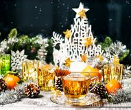 Christmas ornaments Hot tea festive window decoration. Christmas ornaments. Hot tea and festive window decoration Royalty Free Stock Photos