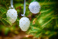 Christmas Ornaments including toys on Christmas tree Stock Images