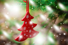 Christmas Ornaments including toys on Christmas tree Royalty Free Stock Photography