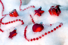 Christmas ornaments lie on the snow in winter Stock Image