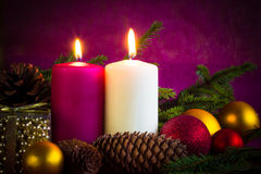 Christmas ornaments lighted candles baubles spruce twigs Stock Photography