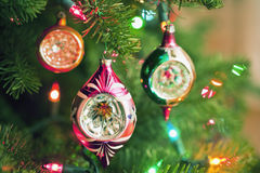 Christmas ornaments and lights on a tree. Christmas ornaments and lights on a holiday pine tree Stock Image
