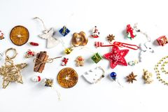 CHRISTMAS ORNAMENTS IN LINE. DECORATIVE ELEMENTS ON WHITE BACKGROUND. MERRY CHRISTMAS. DECORATIVE ELEMENTS PHOTO. BEAUTYFUL ORNAMENT TOOLS STILL LIFE. ISOLATED stock image