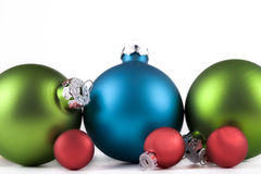 Christmas ornaments lined up, isolated Stock Images