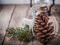 Christmas ornaments and old lamp on rustic wood.  Stock Image