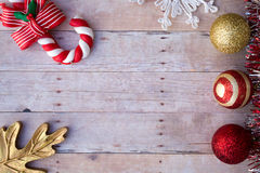 Free Christmas Ornaments On A Wood Background Royalty Free Stock Photography - 63125097