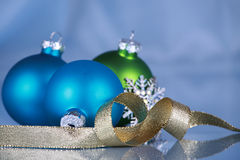Christmas Ornaments On Blue Cloth Background Royalty Free Stock Photos