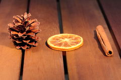 Christmas ornaments. And orange and cinnamon and cone Royalty Free Stock Photo