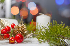 Christmas ornaments. Christmas ornament, fir branch, red berry, fir-cone and candle Royalty Free Stock Photos