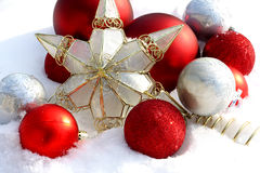 Christmas Ornaments Outside in the Snow stock photography