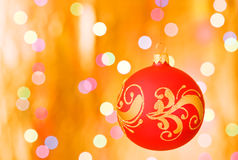 Christmas ornaments over gold blurred background Stock Photos