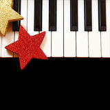 Christmas ornaments on piano Stock Photo