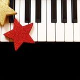 Christmas ornaments on piano Stock Photo