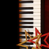 Christmas ornaments on piano Stock Photography