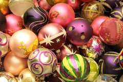 Christmas Ornaments. Pile of glass, handpainted christmas ornaments in various colors stock images