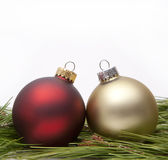 Christmas ornaments. On pine needles Royalty Free Stock Image