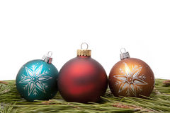 Christmas ornaments. On pine needles Royalty Free Stock Photos